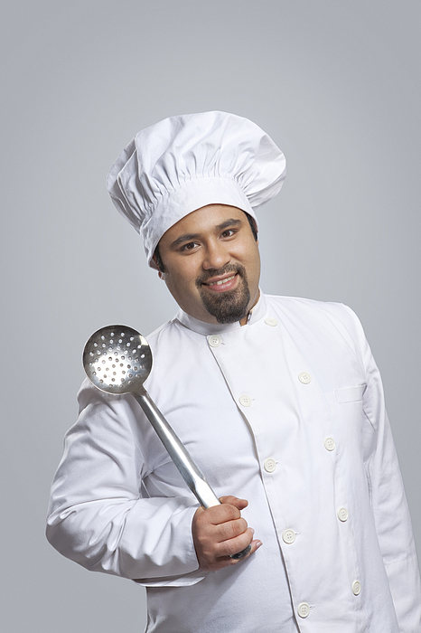 Portrait of chef holding a skimmer Photograph by Ravi Ranjan