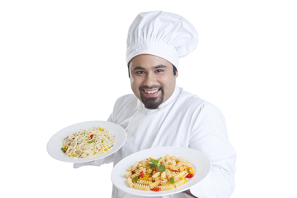 Portrait of chef holding plates with pasta Photograph by Ravi Ranjan