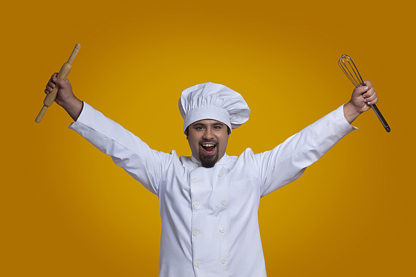 Portrait of chef holding wire whisk and rolling pin Photograph by Ravi Ranjan
