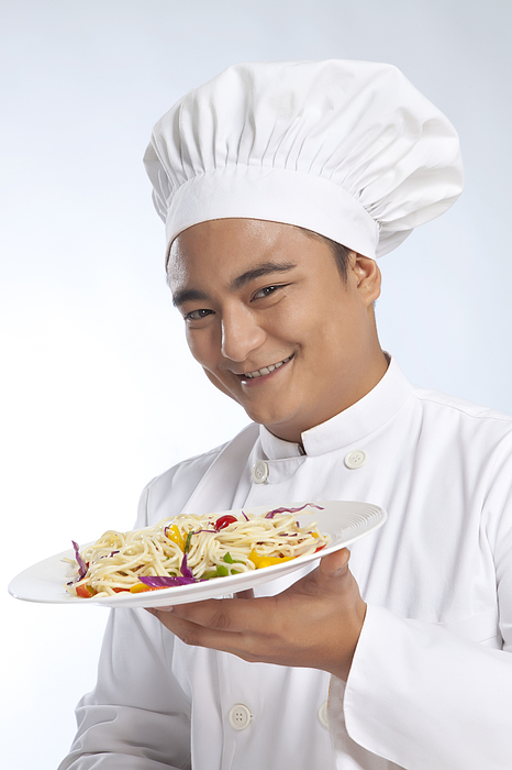 Portrait of chef with plate of noodles Photograph by Ravi Ranjan