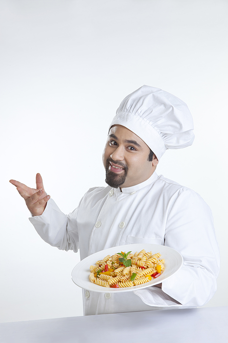 Portrait of chef with plate of pasta Photograph by Ravi Ranjan
