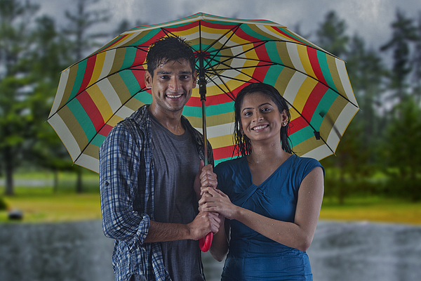 Portrait of couple with umbrella Photograph by Abhinandita Mathur