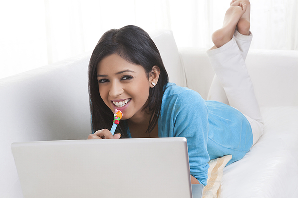 Portrait of girl with laptop smiling Photograph by Ravi Ranjan