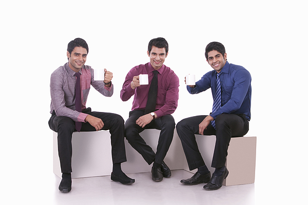 Portrait of male executives with mugs of tea Photograph by Sudipta Halder