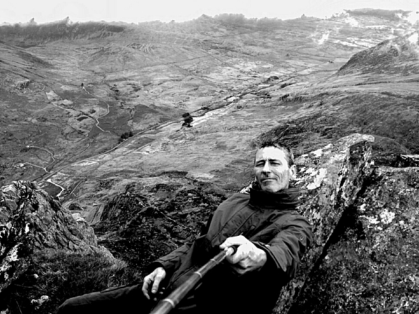 Portrait Of Man Talking Selfie On Mountain Photograph by Mark Hughes / EyeEm