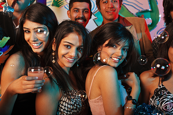 Portrait of men and women at a party Photograph by Visage