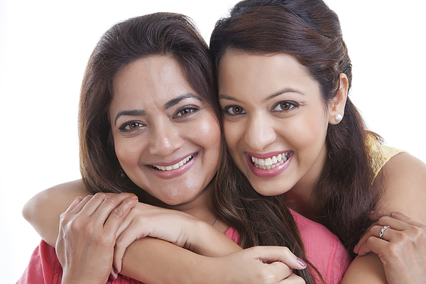 Portrait of mother and daughter smiling Photograph by Ravi Ranjan