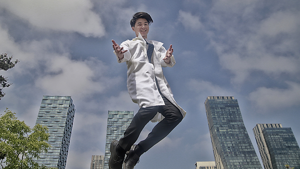 Portrait Of Smiling Doctor Jumping Photograph by Runstudio