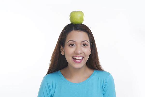 Portrait of woman balancing apple on head Photograph by Sudipta Halder