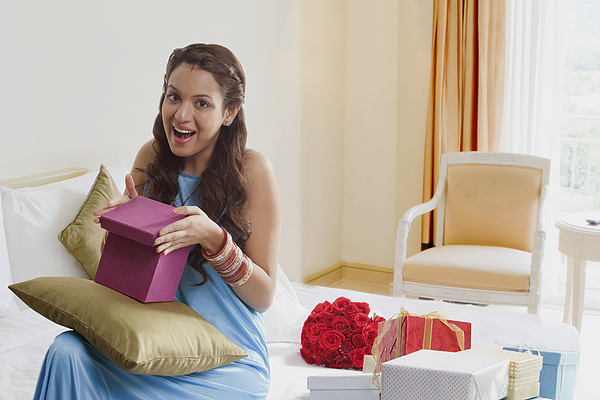Portrait of woman opening gift box Photograph by Hemant Mehta