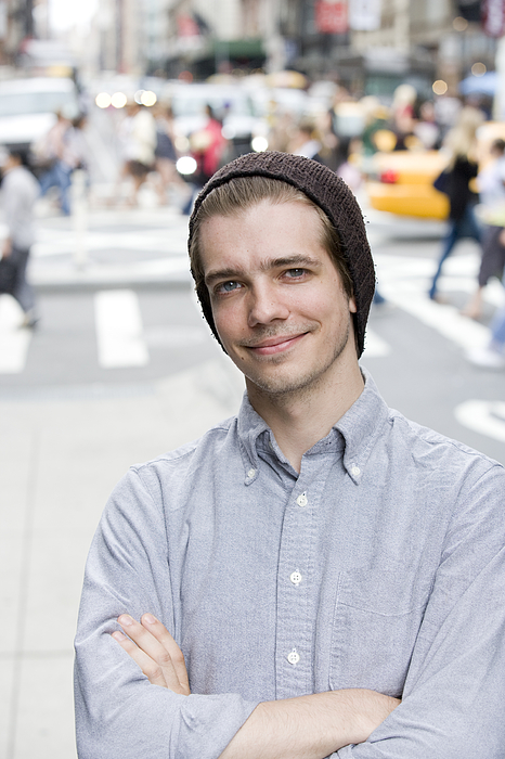 Portrait of young Caucasian man in downtown city Photograph by FangXiaNuo