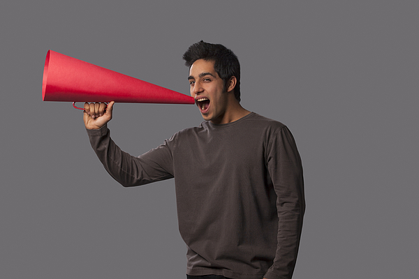 Portrait of young man with megaphone Photograph by Hemant Mehta
