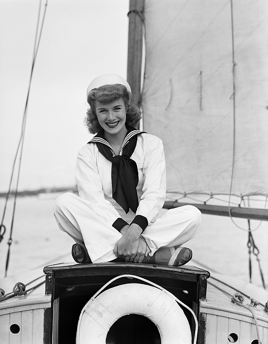 Portrait of young woman in sailor suit on ship Photograph by George Marks