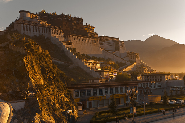 Potala Palace at sunrise. Photograph by Merten Snijders
