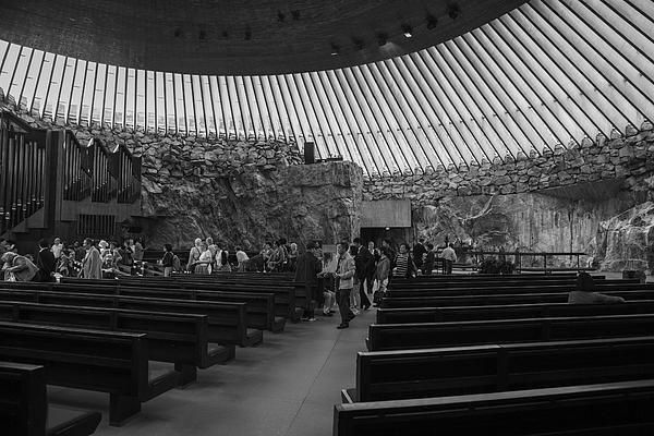 praying in Temppeliaukion Church excavated into rock at helsinki finland Photograph by Tekinturkdogan
