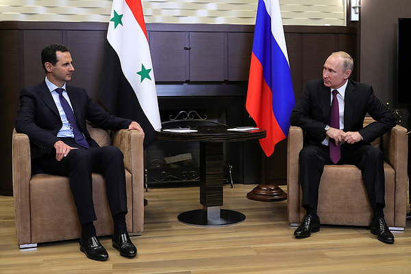 Presidents of Russia and Syria meet in Sochi Photograph by Mikhail Klimentyev