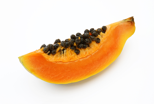 Quarater of a fresh, ripe papaya or paw paw. Photograph by Rosemary Calvert