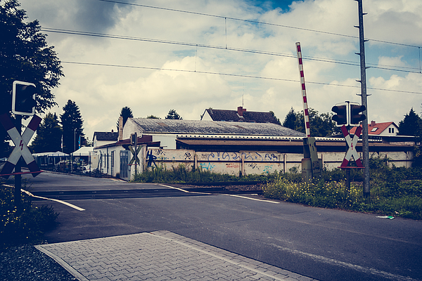Railroad With Buildings In Background Photograph by Albrecht Schlotter / EyeEm