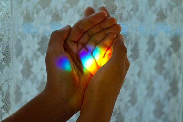 Rainbow Light In Her Hands Photograph by MamiGibbs