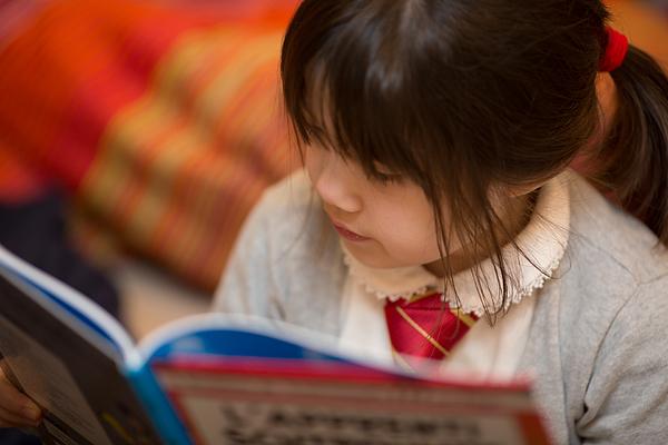 Reading a book Photograph by Benoist SEBIRE