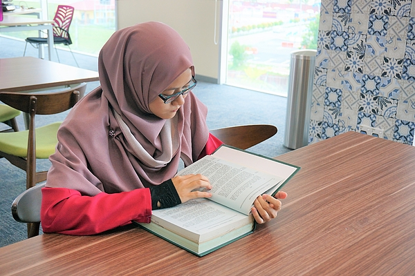 Reading concept of Muslim woman reading book Photograph by Badins