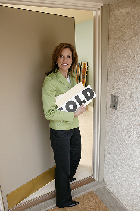 Realtor Opening Door Photograph by Comstock Images
