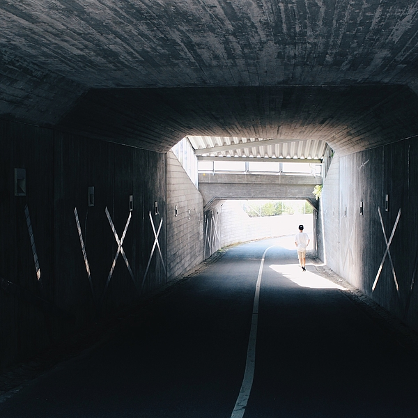 Rear View Of Boy Walking In Tunnel Photograph by Johanna Lindberg / EyeEm