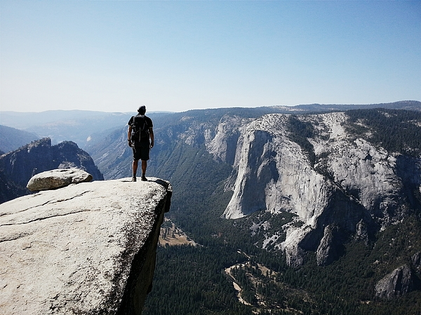 Rear View Of Man On Mountain Against Clear Sky At Yosemite National Park Photograph by Patrick Walsh / EyeEm