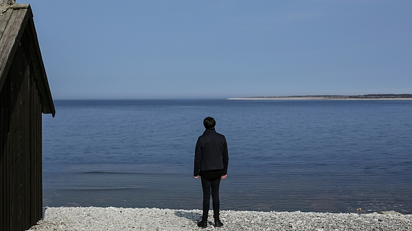 Rear View Of Person Standing At Seaside Photograph by Alessandro Miccoli / EyeEm