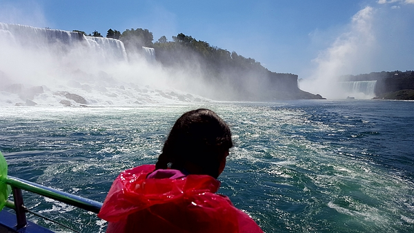 Rear View Of Woman In Ferry Boat At Niagara Falls Photograph by Rosario Cochachi / EyeEm