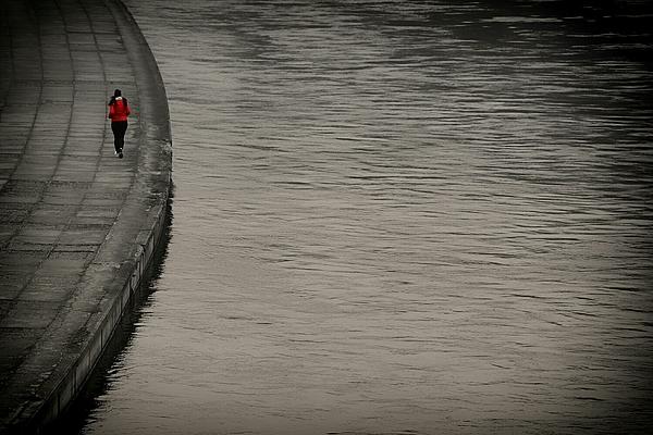 Rear View Of Woman Running On Sidewalk By Lake Photograph by Dainius Dirgela / EyeEm