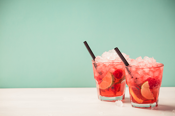 Red drink with ice Photograph by Klenova