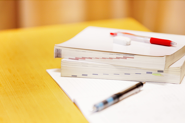 Reference book and writing instrument Photograph by Taka4332