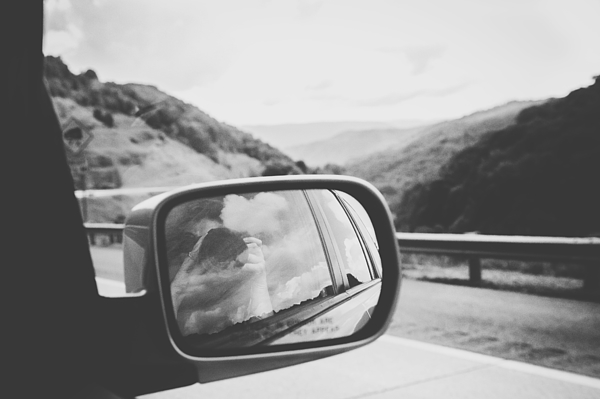Reflection Of Woman Photographing On Car Rear-view Mirror Photograph by Brandi Thompson / EyeEm