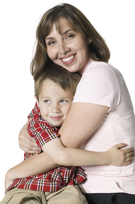 Relationship Portrait Of A Mother Smiling And Hugging Her Young Son Photograph by Photodisc