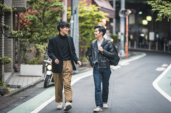 Relaxed Japanese Male Friends Walking and Talking in Tokyo Photograph by AzmanL