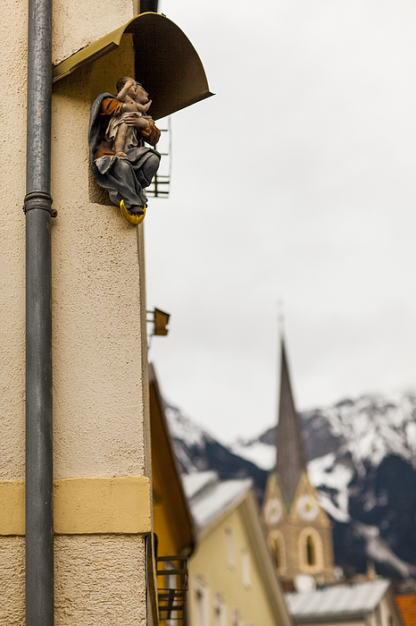 Religious sculptures on street corners Photograph by Merten Snijders
