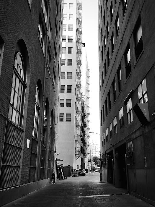 Road Amidst Buildings In City Photograph by Chris Park / EyeEm