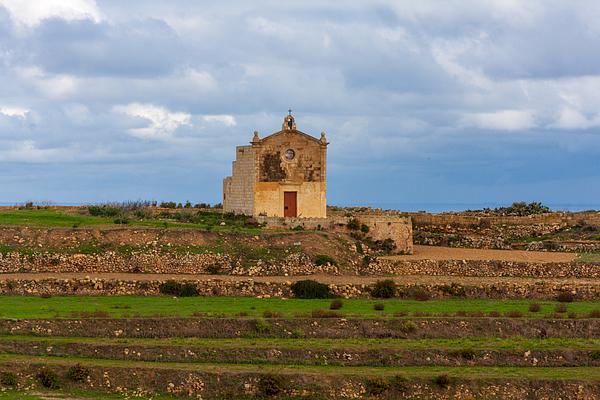 San Dimitri chapel against a cloudy backdrop, Gozo Malta Photograph by Flottmynd