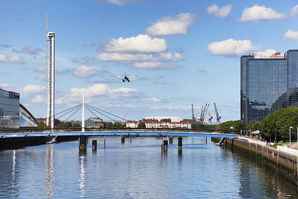 Seaplane Landing In Glasgow Photograph by Theasis