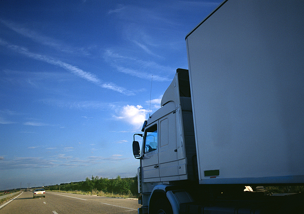 Semi-truck On Highway, Partial View, Road And Blue Sky In Background Photograph by Frederic Cirou