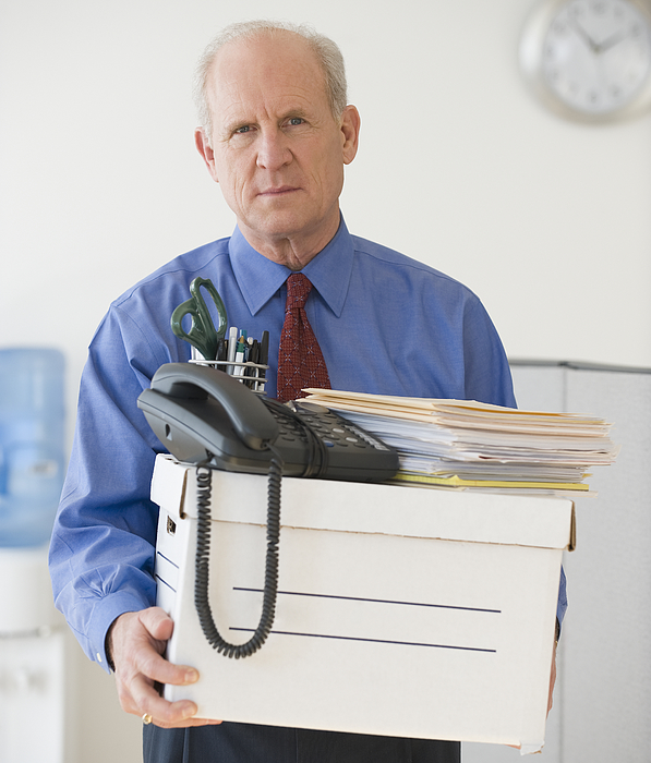 Senior Businessman Carrying Box Of Office Items Photograph by Tetra Images