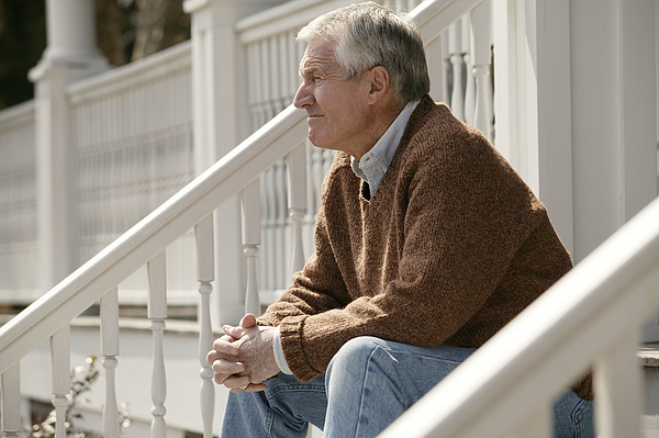 Senior man on porch Photograph by Comstock