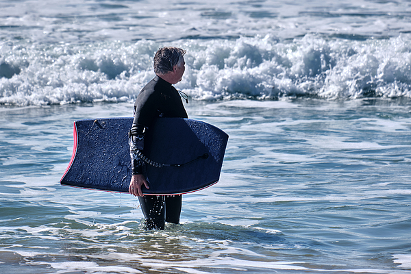 Senior Woman Having Fun With Bodyboarding On The Beach Photograph by Finn Bjurvoll Hansen