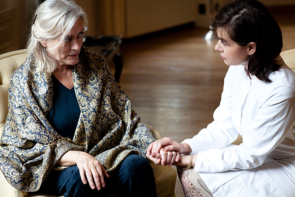 Senior Woman In Care Home Gets Attention From Female Doctor Photograph by Fotografixx
