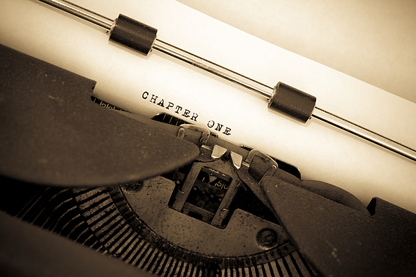 Sepia Toned Vintage Typewriter with Chapter One Typed Out Photograph by Dougall_Photography