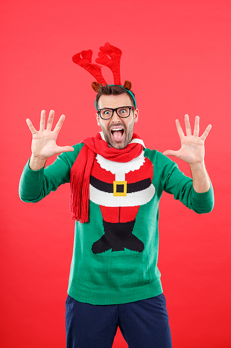Shocked Nerd Man In Funny Winter Outfit Against Red Background Photograph by Izusek
