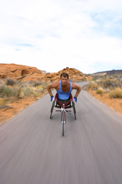 Shot Of A Male Caucasian Wheelchair Racer As He Trains In A Rural Red Rock Setting Photograph by Photodisc
