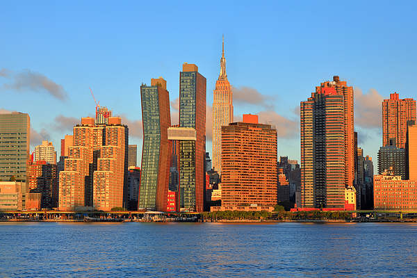 Skyline of Midtown Manhattan with the Empire State Building at sunrise Photograph by Rainer Grosskopf