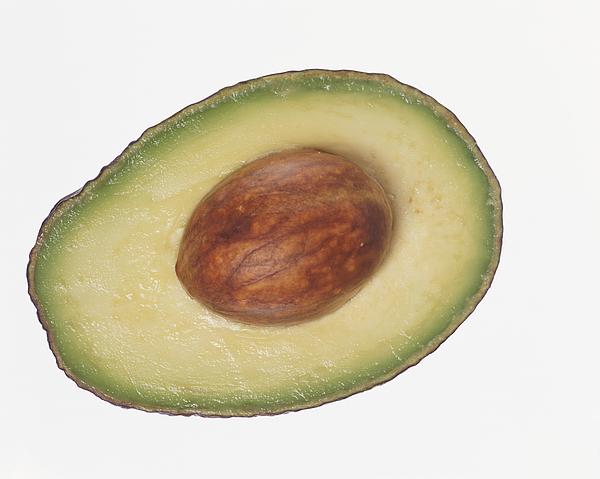 Slice of Avocado Containing a Seed Photograph by Digital Vision.